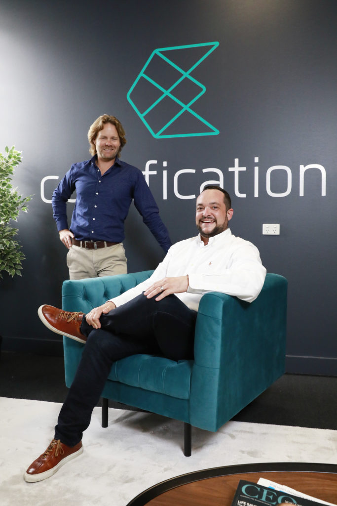 Drew Butler and Daniel Sandaver in front of Codafication wall decal
